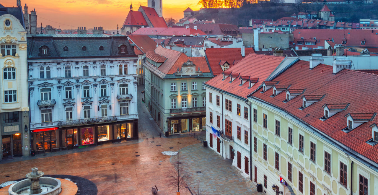 Aerial cityscape image of historical downtown of Bratislava, capital city of Slovakia during sunset.
