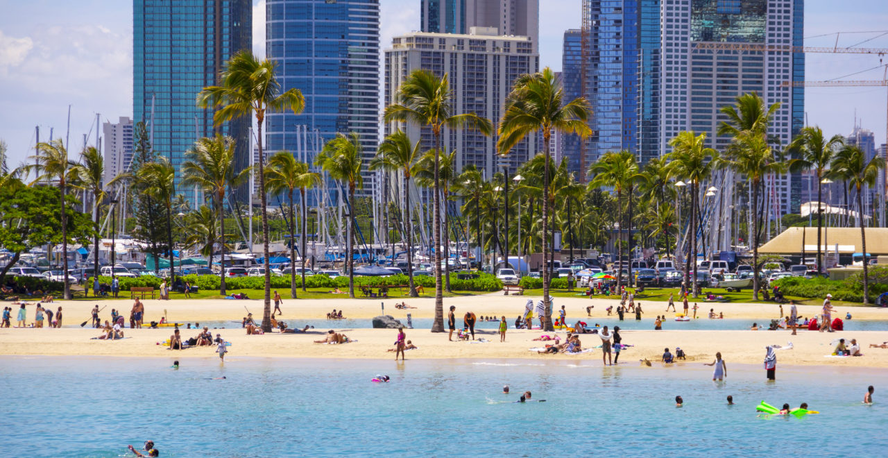 Tourists Swimming, Sunbathing on Waikiki Beach, Honolulu, Oahu, Hawaii., USA