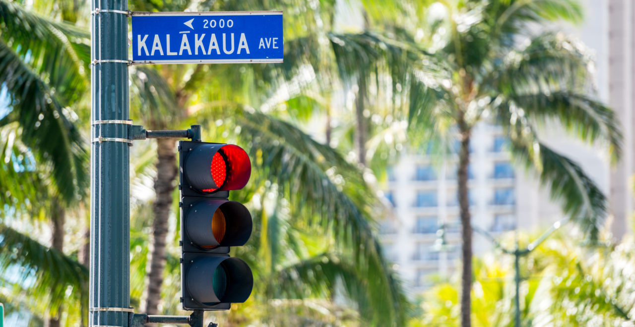 Street sign on Kalakaua Avenue, Honolulu, Hawaii, USA